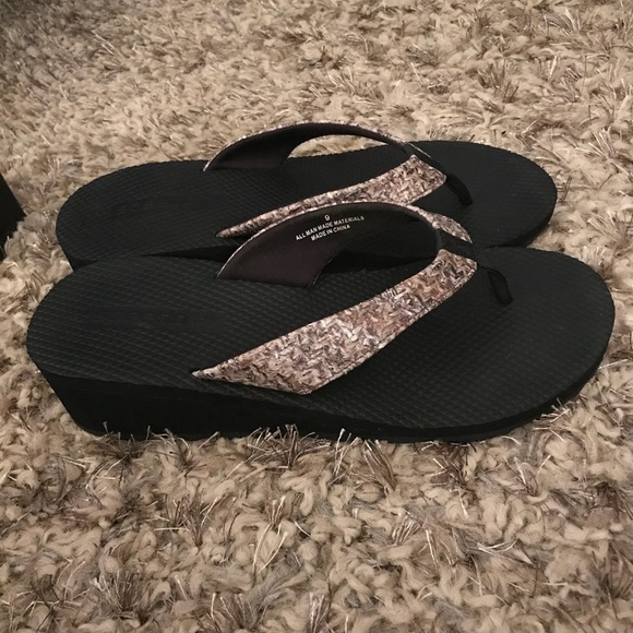 19a272e87 Speedo Women Wedges Brown And Black Size 9. M 5aac6454a6e3eaad10b027da.  Other Shoes you may like. Speedo wedge flip flop